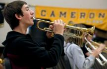 Cameron band members go through the music from their upcoming show for the first time.