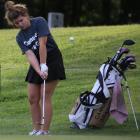 Senior golfer Lexi Hutton chips onto the green Monday.