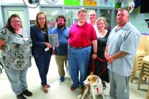 Lori Parkey, P4P Coordinator, WMCC Warden Sherie Korneman, Cooper's family: John Sharp, Shawn Chance, Dennis Mull and Sandra Wallace, Eric Westmoreland, Cooper's offender handler, and the 500th dog adopted, Cooper.