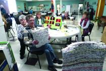 Pat Jones, Sylvia Fenn, Sheryl Anderson, Carol Anderson and Darlene James sit in the Stella Grinstead Center talking about how to make mats and pillows from recycled plastic bags.