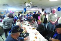 Veterans and their guests enjoy the dinner provided by the Cameron Elks Lodge.
