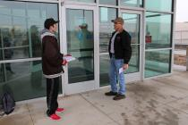 Alex Jager asks Cameron Post Office patrons to sign the petition.