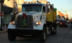 R&W Container comes down Third Street with packages in tow during the Christmas in Cameron Parade.