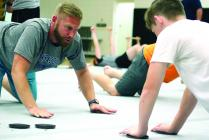 Cameron Regional Medical Center Head Athletic Trainer Josh Murdock works on core exercises during workout in June of 2019