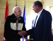 Cameron WWII veteran William Pollard shakes hands with Lt. Gov. Mike Kehoe while receiving the Lt. Governor's Senior Service Award last Thursday.