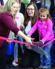 Archetecht Ashley Phillips, SJCAP Director Whiney Lanning and Coraline Eads cut the ribbon.