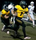 Senior quarterback Ty Campbell sprints for the endzone last Friday.
