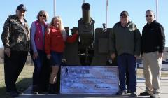 From left, Jim McKinley Barbara Caldwell, Neva Woody, Marvin Gordon and Wayne Pierson pose for a photo with Wood's $57,000 check.