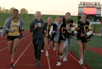The Cameron Lady Dragons do a victory lap following the MEC meet title Tuesday evening in Chillicothe.