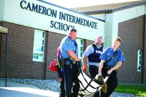 Missouri State Highway Patrolman and Cameron EMS assist a victim during a training drill held at Cameron Intermediate School on Wednesday.