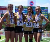 unior Natalie Garr, senior Haley Wilson, junior Ashley Yamat and freshman Bailey Robinson pose for a photo after taking fifth in the 800-meter relay Saturday morning.