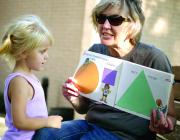 Cameron Public Library Director Jo Ellen Pratt reads a book on counting to Brynleigh Musick.