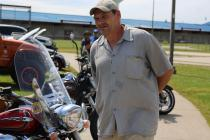 Western Missouri Correctional Center prisoner Chris Jolliff takes a look at motorcycles Saturday.