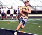 Dom Hurst runs cone drills Monday.