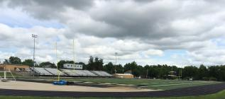 After weeks of hosting various offseason workouts and team camps, Dave Goodwin Field sits dormant following the immediate postponement of all offseason activities. According to the Clinton County Health Department, the recommendation came after a student athlete tested positive for COVID-19 while participating in the recent wrestling team summer camp. The football team, volleyball team and soccer team hope to resume offseason workouts in August.