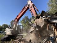 Jarrod Scott with Scott's Construction demolishes a home on Corhhill Street.