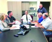Pictured in the meeting are (L to R): Amy Ford, Drew Bontrager, Steve Rasmussen, Verlon Persinger, Richard Riddell and Mark Baker.