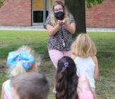 Music teacher Allyson Kapp takes her class outside to teach a lesson on rain Monday.