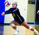 Cameron senior Aly Yates comes up with a dig.