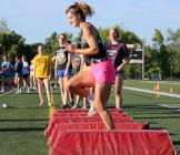 Cameron senior Natalie Garr does high-knee drills during this Tuesday morning's summer conditioning program.
