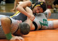 Cameron High School junior lightweight Ashley Yamat holds on for a pin.